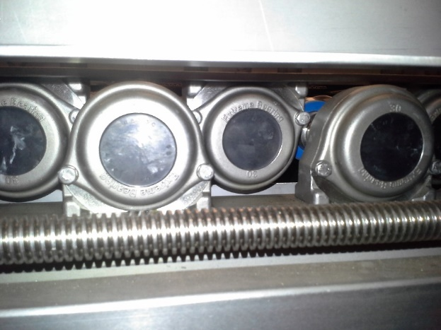 Stainless steel 316 pillow block bearing, type SYF 30 TF mounted on a shelfisch grading machine